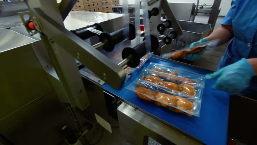 Poultry processing conveyor with cooked meat - HD stock video clip