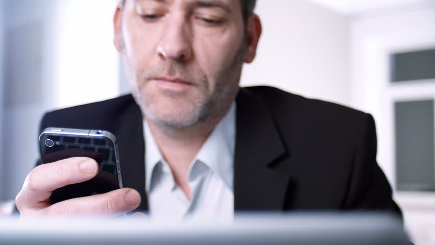 Businessman using his smart phone - tracking shot - HD stock video clip