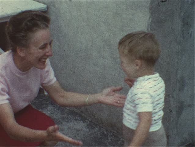 Vintage 8mm film: Mother embraces toddler, 1960s - SD stock footage clip