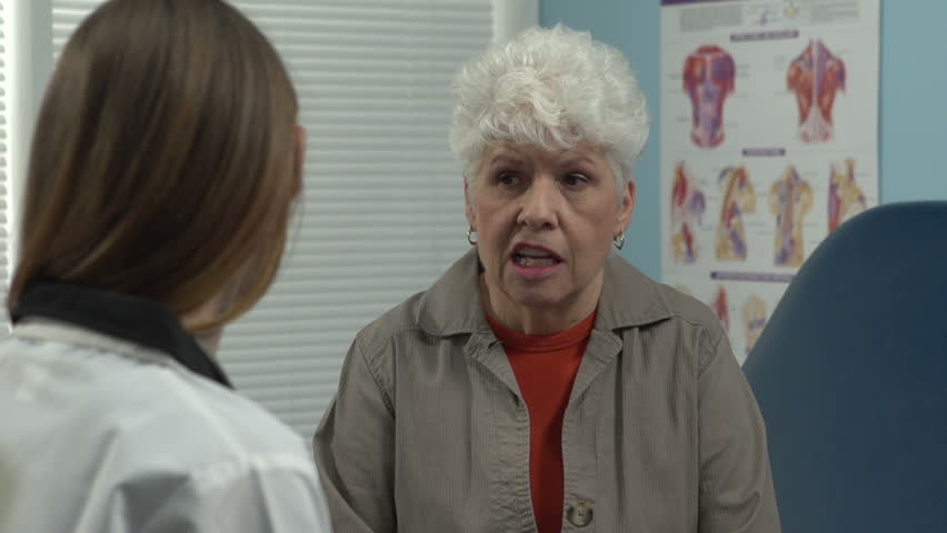 Female doctor talking to senior patient. Over the shoulder   Shutterstock HD Video #3463868