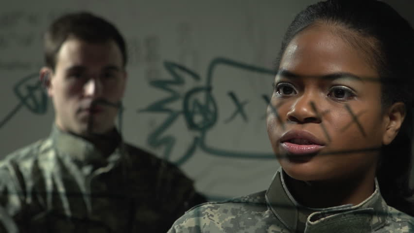 female soldier explaining plan of action to fellow soldier - HD stock footage clip