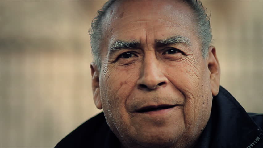 MEXICO, IXCATEOPAN  - CIRCA FEB 2012: Hispanic elderly man smiling during the celebration in memory of the last Aztech emperor circa February 2012 in Ixcateopan, Mexico.