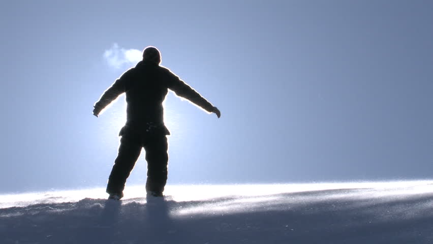 Man in a Worship Pose on Top of a Mountain