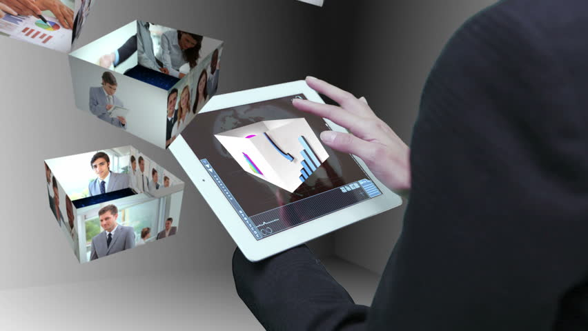 Businesswoman using tablet to view montage of business people at work in holographic form - HD stock video clip