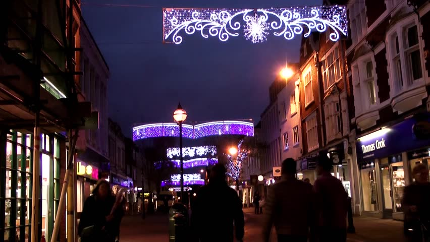 Christmas Street Lights and Shoppers -  Shire Hall, Market Square, Staffordshire, England - HD stock video clip