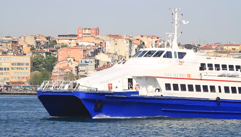 ISTANBUL - APR 28: High speed ferryboat ULUC ALI REIS sails out from Kadikoy Harbor on April 28, 2012 in Istanbul. A 39 mt long, 9 mt width catamaran ship has a speed of 13,2 knots. - HD stock footage clip