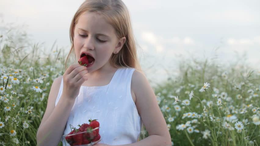 Child eating strawberries #3553994