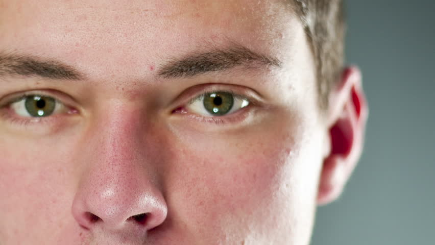 very close Zoom in of a mans eye - like a fly thru