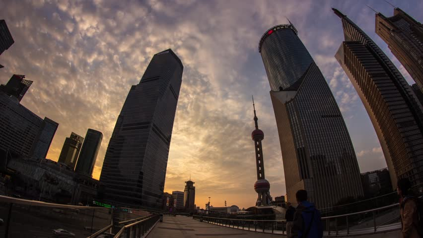SHANGHAI - CIRCA 2013: Time Lapse of Sunset Clouds in Pudong, with East Pearl Tower and IFC Buildings in Pudong, Shanghai, China. It was a Cloudy night with crowds traffic and automobile traffic
