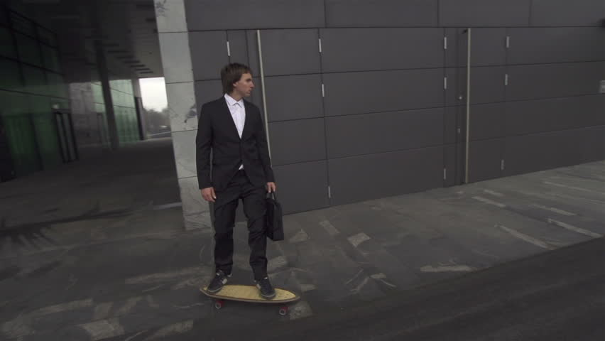 Businessman long boarding to job - HD stock footage clip