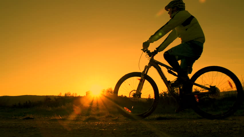 SLOW MOTION: mountain biker pulls a wheelie | Shutterstock HD Video #3581282