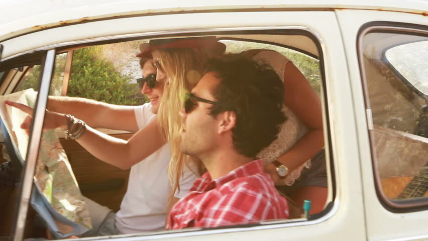 Young Hipster friends on a roadtrip looking at a map. | Shutterstock HD Video #3591254