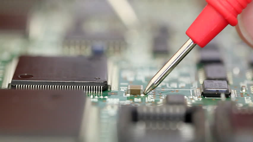 Close up of electronics engineer checking a circuit board #3603251