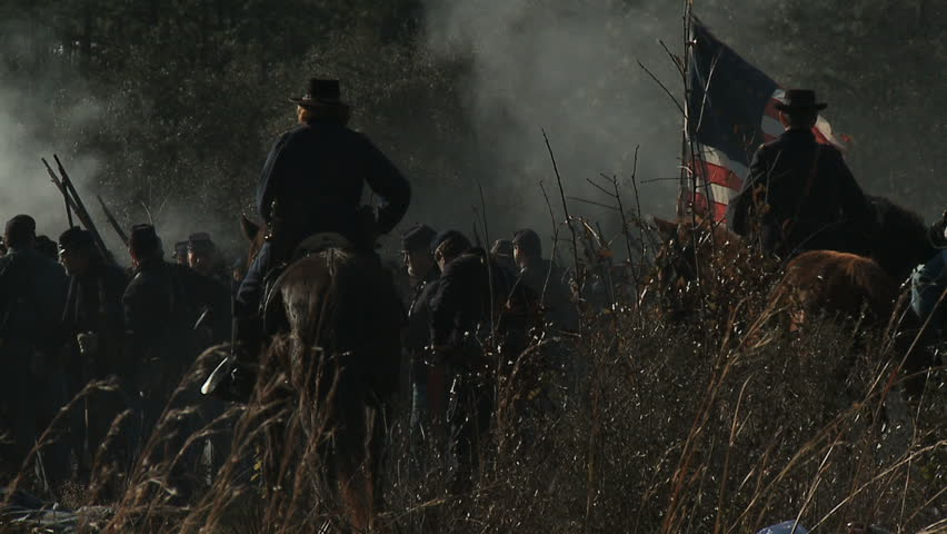 FLORIDA - FEBRUARY 2013 - large-scale, epic Civil War anniversary reenactment -- in the middle of battle.  Smokey battlefield behind the Union battle line as Commanding General commands troops. - HD stock video clip