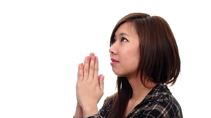A young asian christian women praying.