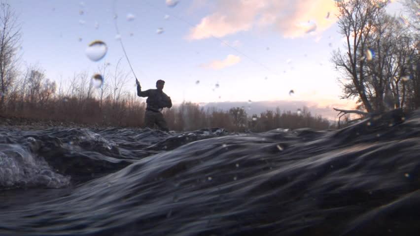 Fly fisherman shot from underwater camera near waves | Shutterstock HD Video #3608858