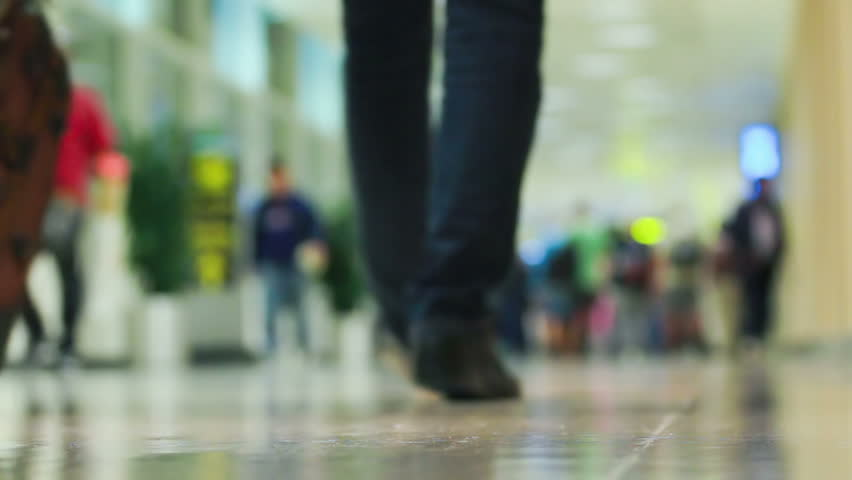 Crowd of people walking with luggage in the international airport, de-focused scene - HD stock footage clip