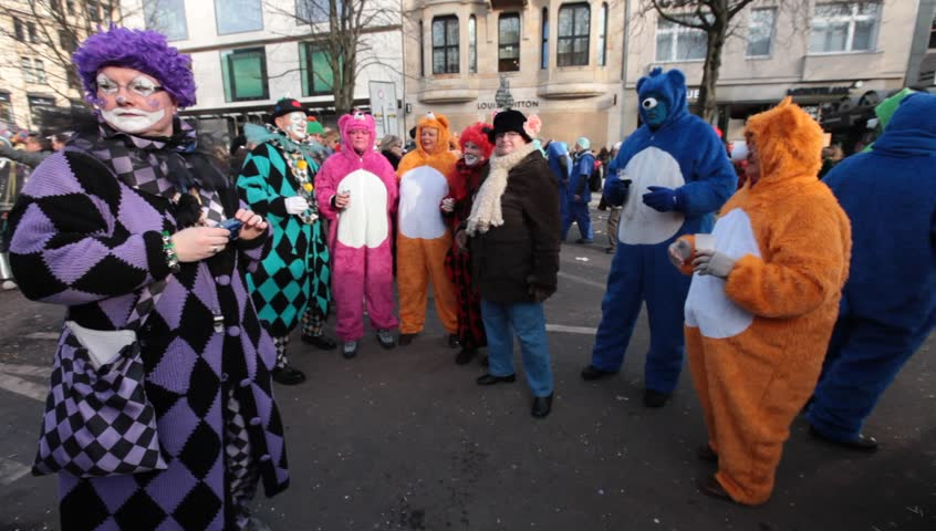 DUSSELDORF, GERMANY – FEBRUARY 10: People present their costumes for the next day celebration of Rosenmontag Karneval or Carnival. February 10, 2013,  Düsseldorf, Germany  - HD stock footage clip