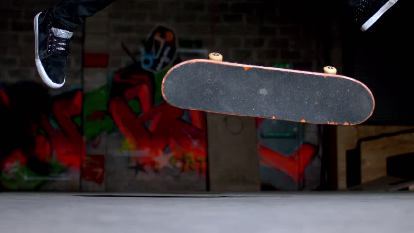 Close up of skater doing 360 flip trick in slow motion - HD stock footage clip