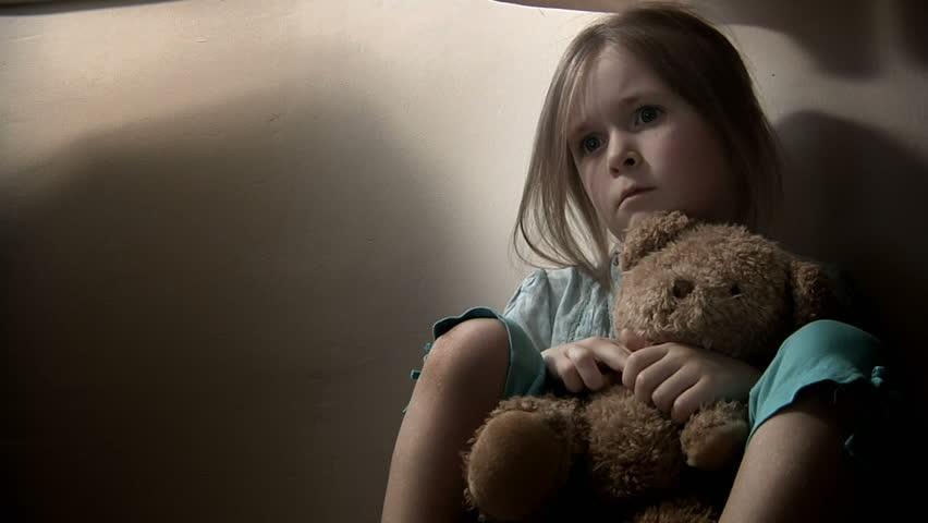 Sad Little Girl, Clutching Her Teddy Bear. Intentionally