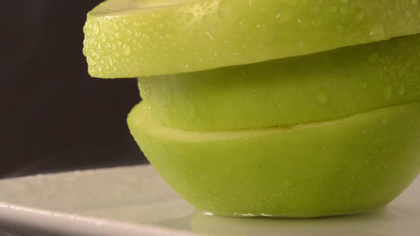 Rotating Sliced Green Apple - Crane Up