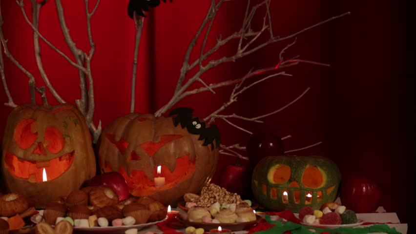 A composition of illuminated pumpkins,sweets and branches. Dolly shot. | Shutterstock HD Video #3640898