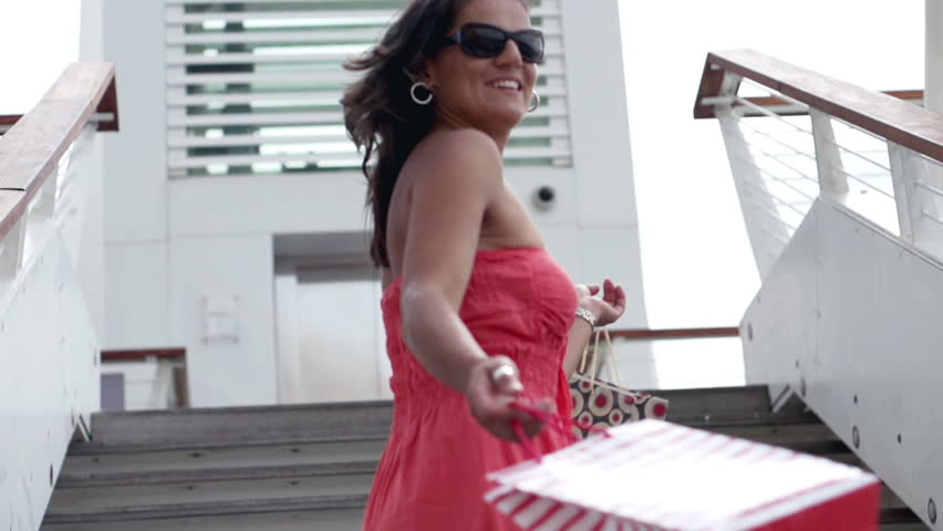 Happy woman after shopping descending the stairs, slow motion shot at 240fps  | Shutterstock HD Video #3647180