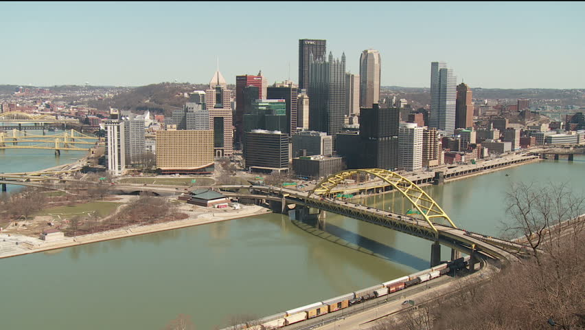 The downtown area including the skyline, bridges, and Point State Park at the confluence of the Allegheny and Monongahela Rivers in Pittsburgh, Pennsylvania. - HD stock footage clip