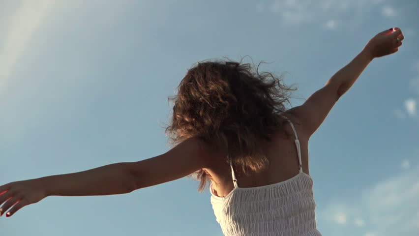 Happy woman dancing outdoors, super slow motion, shot at 240fps  - HD stock video clip