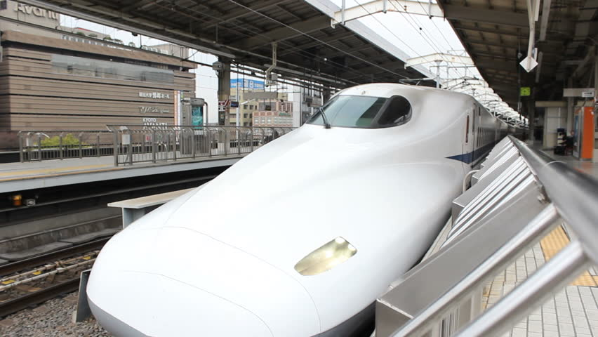 KYOTO - CIRCA MARCH 2013: A Shinkansen (Bullet Train) departs Kyoto Station Kyoto, Japan circa March 2013.