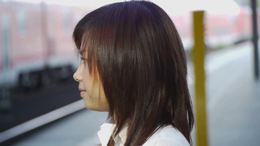 HD1080 Young asian woman looking around on train station. Portrait. - HD stock footage clip