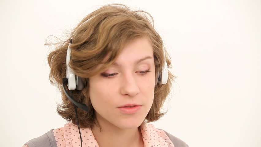 Woman talking over the headset, customer support center | Shutterstock HD Video #3681659