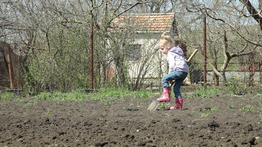 Little Girl Gardener Digging on Smallholder Farm - HD stock footage clip