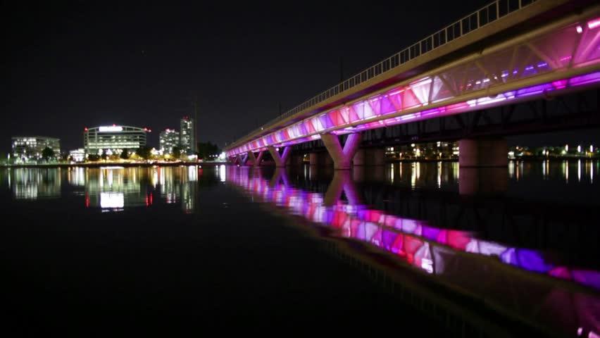 Time-lapse of Tempe Railroad Bridge displaying a rapid lightshow at night in Arizona.