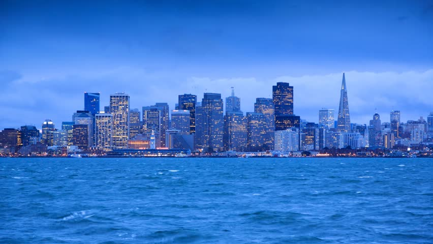 San Francisco skyline from twilight to night. View from Treasure Island. Timelapse.