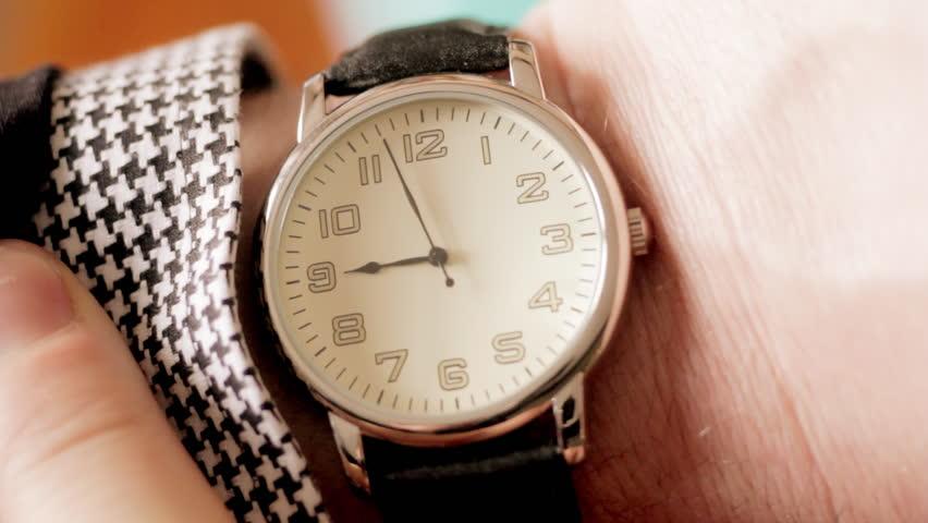 Businessman checking wrist watch