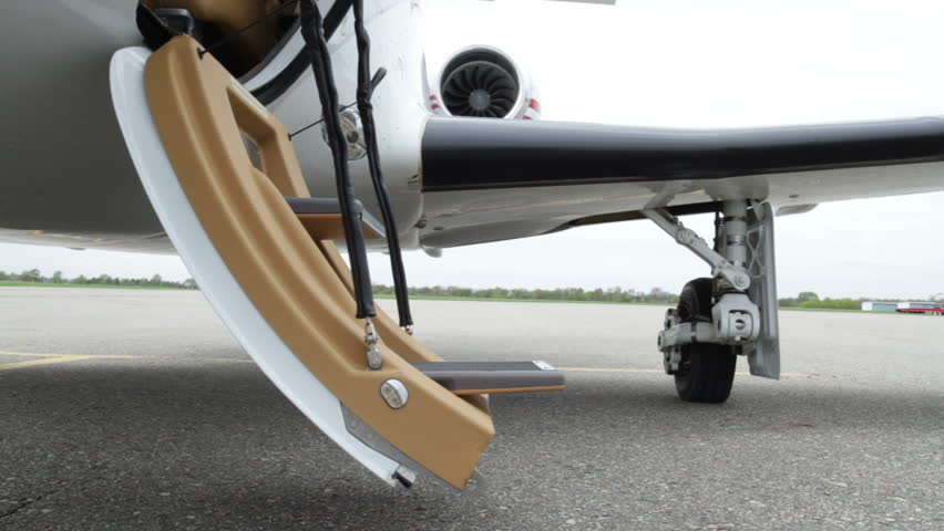 Executive woman's legs with high heels exiting and then boarding a private jet. Close up from front angle.