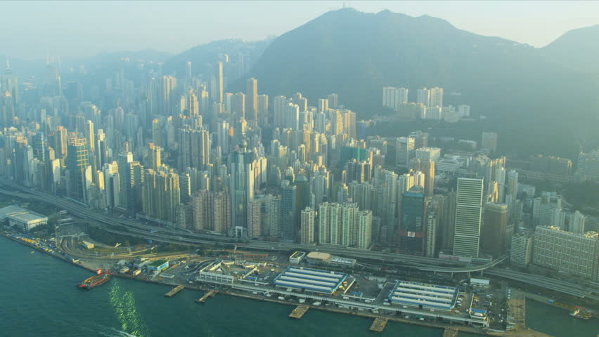 Aerial view of causeway highway and Hong Kong city skyscrapers, Victoria Harbour, China, Asia, RED EPIC | Shutterstock HD Video #3741086