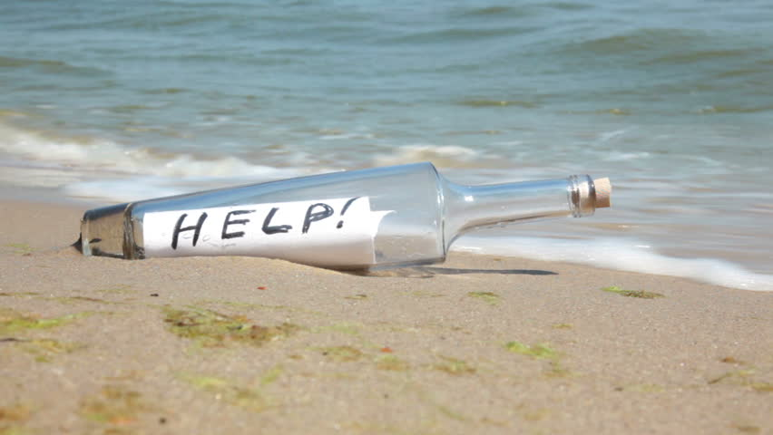 Beach. Sunny weather. Sand. Surf wave brought a bottle with a note inside. It