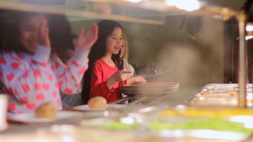 School food - children in a line receiving food from the school canteen   Shutterstock HD Video #3797561