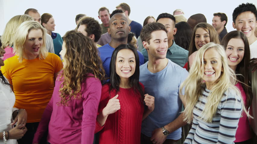 Portrait of a happy and diverse multi-ethnic group of people in colorful casual clothing, isolated on white in a studio shot. They are all cheering and celebrating a successful event.