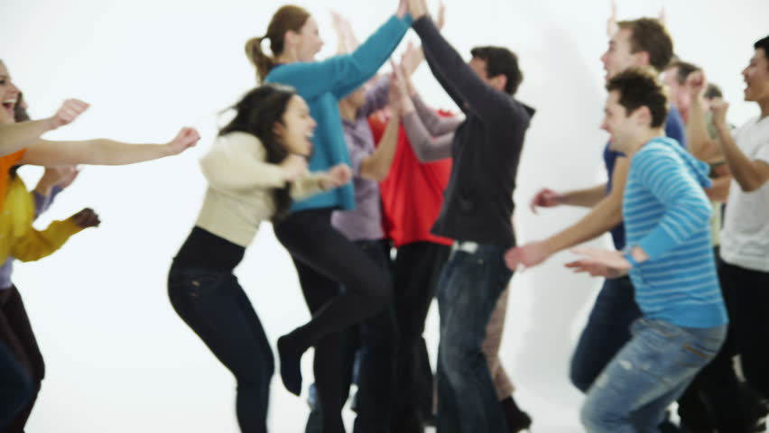 A happy and diverse multi ethnic group of people in colorful casual clothing run towards each other in a long line, cheering and celebrating. Isolated on white in a studio shot. In slow motion.