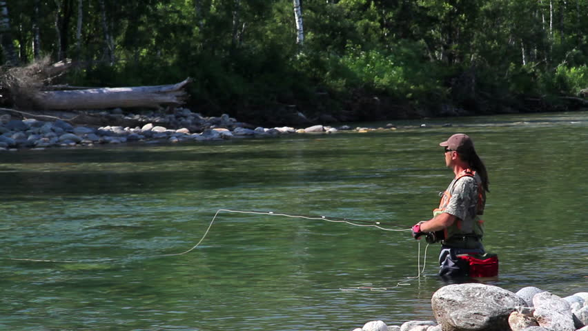 Fly fishing for trout fishing man in a professional for Professional fishing gear