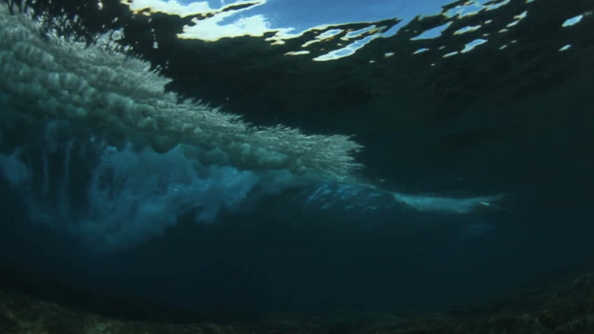 Underwater angle of tropical blue ocean wavebreaking