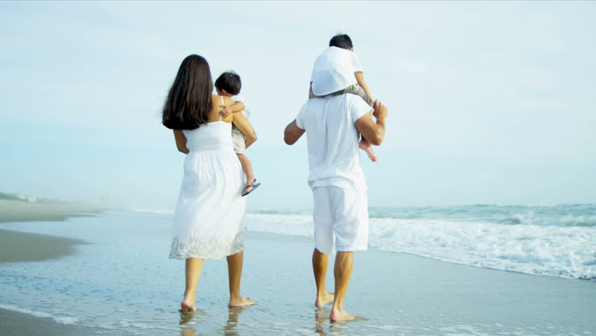 Latin American family enjoying summer holiday on beach shot on RED EPIC - HD stock video clip