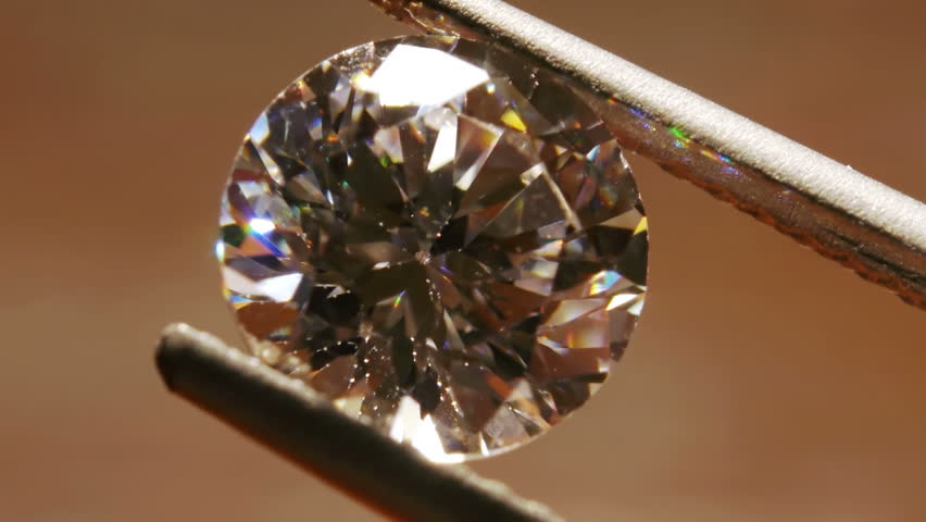 Diamond Seen Close Up With Pincers | Shutterstock HD Video #3828017