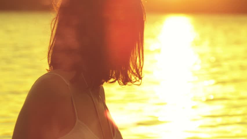 Young woman watching the sunset, Shot on RED EPIC - HD stock footage clip