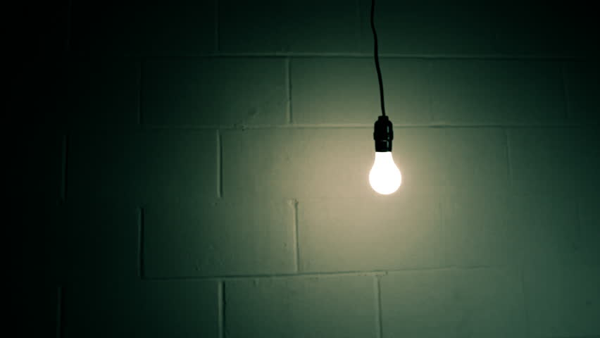 Abstract Swinging Light Bulb In Dark Room Stock Footage ...