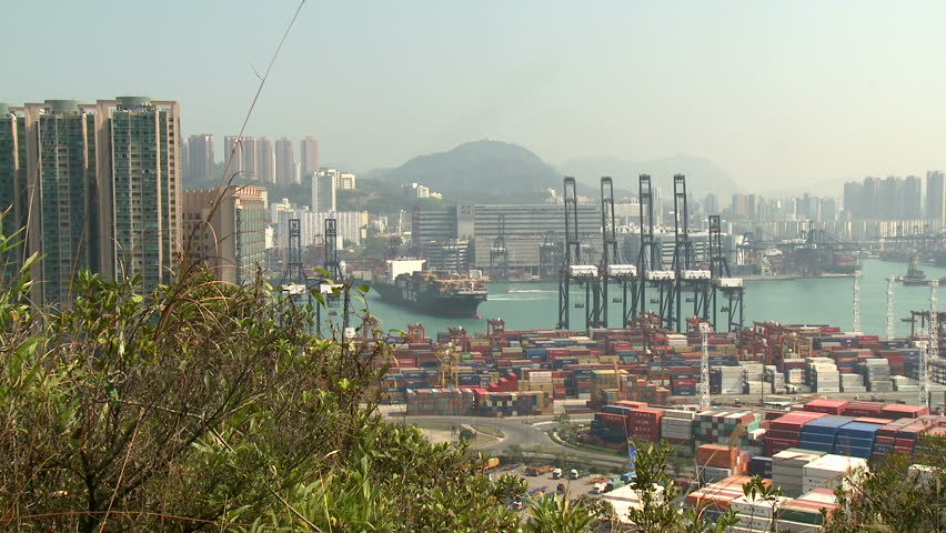 HONG KONG, CHINA - AUGUST 2012: Container Ship Maneuvering In Port Wide Shot.