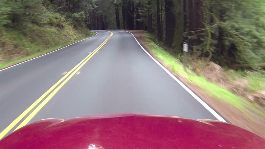 Driving California redwood passing rv and cars point of view right side road. Vacation travel in vehicles along scenic byway and roads. Redwood National and State parks with old and new growth trees. - HD stock footage clip